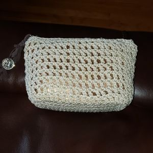 The sak knit / crocheted makeup bag